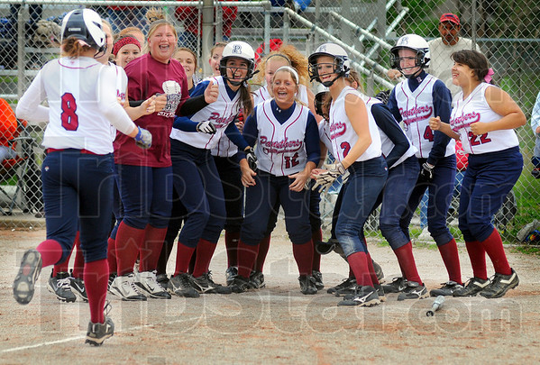 Tribune-Star/Jim Avelis<br /> Welcome home: Sarah Burnham is welcomed home by her team mates after a three-run home against Terre Haute South.