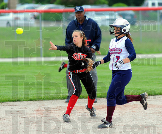 Tribune-Star/Jim Avelis<br /> Short throw: Terre Haute South second baseman Alexis Higgins tosses to Kelsey Marlow to force out Riverton-Parke baserunner Shelby Edington.