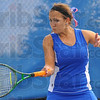 Tribune-Star/Jim Avelis<br /> Happy returns: Anna Potter hits a forehand in her match with Taylor davis.