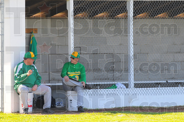Tribune-Star/Jim Avelis<br /> Lonley at the top: North Central coaches Gary Withem and Craig Grow talk with an empty dugout behind them. They fielded only 9 players against West Vigo Friday night.
