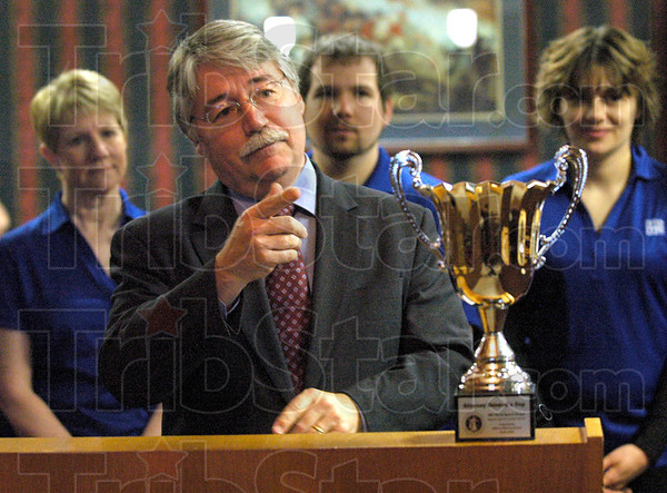General's Cup: Indiana Attorney General Greg Zoeller makes a point during the presentation at Fleschner, Stark, Tanoos and Newlin Law Firm Wednesday morning. f