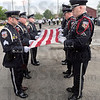 Flag folding: Members of the Terre Haute Police Department Honor Guard fold the flag during a ceremony at police headquarters Monday afternoon