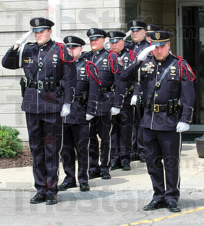 Salute: Members of the Terre Haute Police Department Honor Guard salute the fallen during Monday's ceremony at police headquarters.