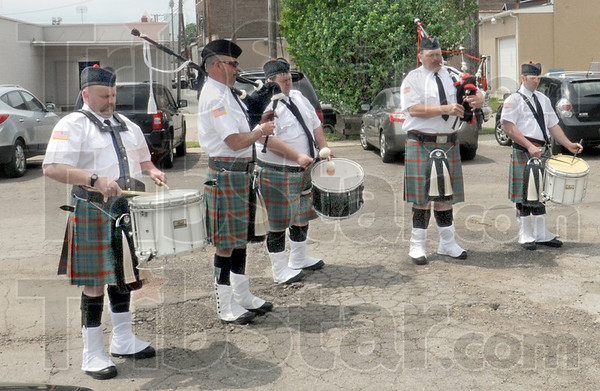Laddies: Members of the Terre Haute Fire Department perform during Monday's fallen heroes event.