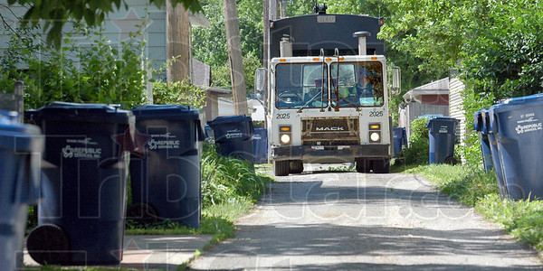 Pickup: A Republic Services truck works in the Collett Park area Monday morning picking up trash.