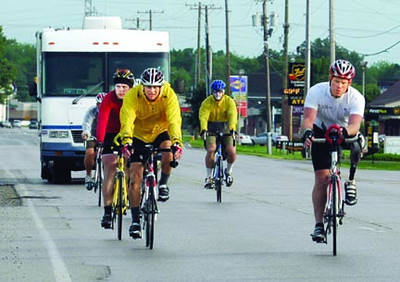 Amputee: Amputee Scott Lane leads his group down south Seventh Street as they arrive in Terre Haute Monday evening.