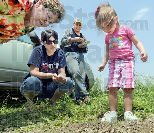 Family time: Melissa Wernz (L) enjoys time with her son Aaron and Aaron's wife and daughter Stephanie and Raegan during a short lunch break. Aaron is farming a field near Marshall, Illinois.