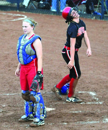 Reaction: South's #17, Kelsey Marlow reacts to scoring a run during sectional action against Martinsville. Martinville catcher Mackenzie Daily watches the play on the field.