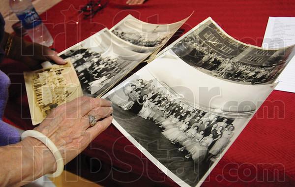 Tribune-Star/Rachel Keyes<br /> Memories: Bekki Dyer thumbs through some old pictures brought in my alumni of Blackhawk High School.