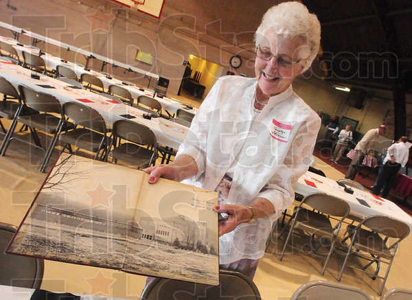 Tribune-Star/Rachel Keyes<br /> Blackhawk pride: Carolyn Thorne class of 1954 show off a picture of the old school and gym at the annual alumni Blackhawk High School banquet.