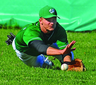 Tribune-Star/Jim Avelis<br /> Not quite: Dylan Aff can't quite reach a short line drive from his position in center field.