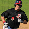 Tribune-Star/Jim Avelis<br /> Touch them all: Richard Wheatfill smiles as he rounds third base on his way home with a homerun against Martinsville.