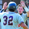 Welcome home:Thomas Finzel greets David Knight(32) after Knight scored a run for the Terre Haute North team.