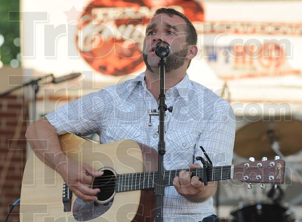 Tribune-Star/Rachel Keyes<br /> Jamming out: Matt Westerfield sings an acoustic version of Zac Brown Bands Highway 20 Ride.