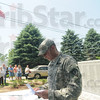 Tribune-Star/Rachel Keyes<br /> Thank you: Commander of the VFW post 6653 Ronald Capps gives a speech on the importance of Memorial Day, and gives a thank you to the Troskey family for their years of service and the donation of this Memorial to the community.