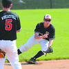 Observer: Terre Haute South thirdbaseman Richard Wheatfill watchers shortstop Jacob Johnson scoop up a ground ball.