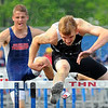 Tribune-Star/Jim Avelis<br /> Leaping ahead: Brave Jeremy Patterson clears the last hurdle in winning the 110 meter event.