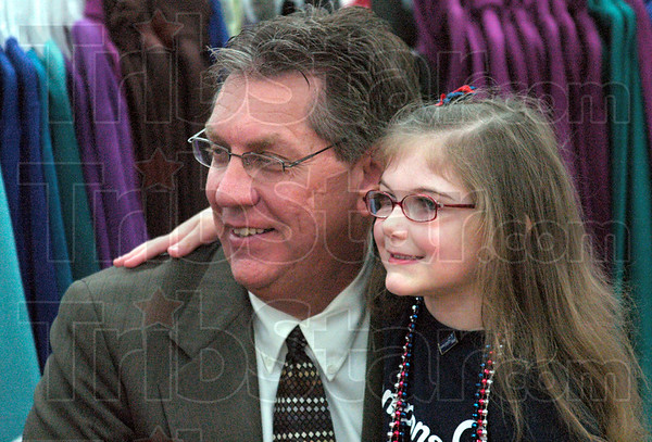 Mayor and me: Olivia Pierce puts her arm around Mayor Duke Bennett to be photographed during Tuesday's event at the Walmart Super Center.