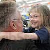 Ambassador: Rod Henry, President of Terre Haute Chamber of Commerce greets four-year-old Olivia Pierce as she arrives at Walmart Tuesday morning.