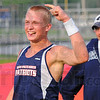 Tribune-Star/Jim Avelis<br /> Happy: A.J. Hughes rejices in clearing ?????? in the pole vault. His coach Matt Presnell is behind him.