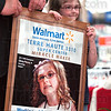 Poster: Four-year-old Olivia Pierce holds her poster during Tuesday's event at Walmart Super Center.
