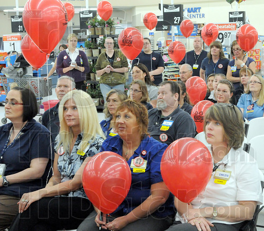 Supporters: Walmart employees and associates listen to Walmart Super Center manager Gary Francis during Tuesday's event.