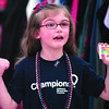 "For the kids: Four-year-old Olivia Pierce takes a credit card and gestures that she's going "" shopping for the Riley kids"" during Tuesday's event at the Walmart Super Center."