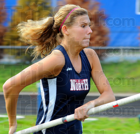 Tribune-Star/Jim Avelis<br /> Concentration: Rachel Welker is all busines as she heads down the runway in the pole vault.