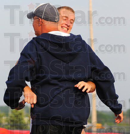 Tribune-Star/Jim Avelis<br /> Thanks, coach: Terre Hqaute North pole vault coach Matt Presnell gets a hug fron vaulter Conner Curley after Curley hit the qualifying mark for the state track meet.