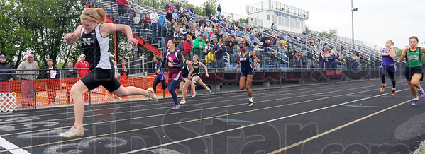 Tribune-Star/Jim Avelis<br /> Cruising: Northviews' Leanna Knight wins the 100-meter dash handily on the Terre Haute North track Tuesday night.