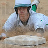 Tribune-Star/Jim Avelis<br /> Safe: Lucas Fagg slides safely into third on a passed ball. He later scored West Vigo's first run of the game.