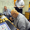 Tribune-Star/Jim Avelis<br /> Contact: Doug Mullens talks with Homeland Security in Indianapolis via a Clay County link on the Ham Radio Operators room in the EMA building at Hulman Field. With him are Steve Ridge and Nick Vinardi.