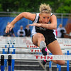 Tribune-Star/Jim Avelis<br /> Fastest: Northviews' Annie Smiley clears the last hurdle to win the 100-meter event.
