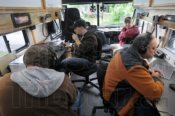 Exercise: Clay County emergency responders Kevin Berlen, John Shepherd, Wayne Stoops and Andy Whittington work from their mobile command post Tuesday morning during the multi-state preparedness exercise.