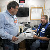 Exercise talk: Gary Adams and Mark O'Heir discuss the on-going disaster exercise from the mobile command center Tuesday morning.