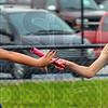 Tribune-Star/Jim Avelis<br /> Your turn: Terre Haute Norths' Sarah Fears takes the baton from starter Kelsey Thomas to run the second leg of the 4x100 relay. The Patriot team placed second to Northview.