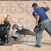 Show: Northview catcher #29, Jessica LaTourette shows the ball to the umpire after tagging South's #34, Alexis Shipley as she attempted to score durng their sectional softball game Tuesday evening.