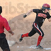 Score: South's #6, Ciara hall rounds third base enroute to scoring durng late game action against Northview. Coach Steve Woerner sends her home.