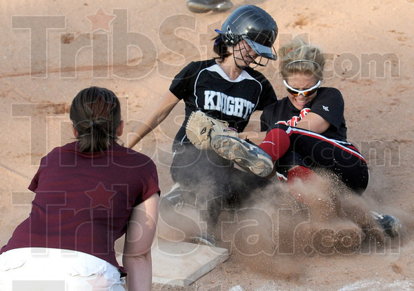 Collision: Northview's #2, Kindra Cox slides into South shortstop #17, Kelsey Marlow as she covers third base durng game action Tuesday. Cox was tagged out on the play. Northview coach Bethany Jones watches the action at left.