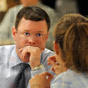 Concerned: Chauncey-Rose principal Greg Gauer listens to the concerns of parent Yvonne Akers prior to the start of the meeting Tuesday evening at the school.