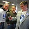 Tribune-Star/Jim Avelis<br /> Results are in: Looking over election results about 6:15 p.m. Tuesday night are John Love, Donnie Pruett and Terre Haute mayoral candidate Mick Love. The first report to come to the Love camp showed him behind eventual winner Fred Nation by about 1,000 votes.