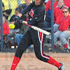 Tribune-Star/Jim Avelis<br /> Hitter: Brave Kaitlyn Pluta drives a hit against their crosstown rivals Tuesday evening on the North diamond.