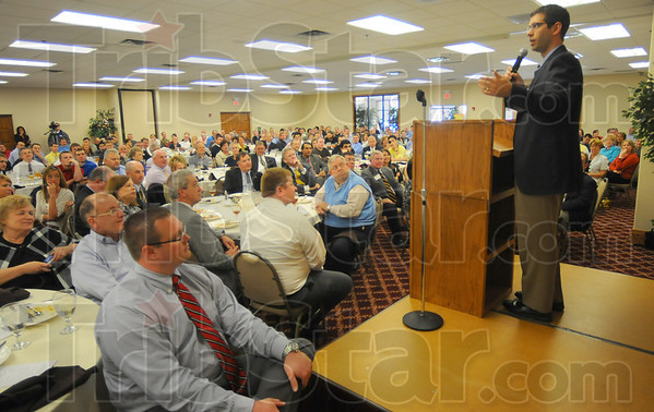 Tribune-Star/Jim Avelis<br /> Big draw: Butler Coach Brad Stevens addresses a packed house at Idle Creek Tuesday afternoon. The event was a fundraiser for Wabash Valley Youth For Christ.