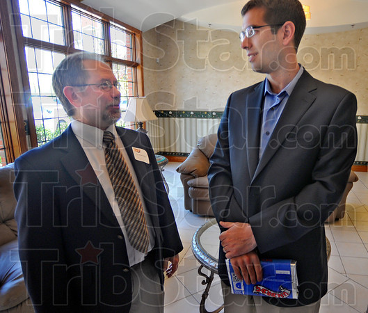Tribune-Star/Jim Avelis<br /> Host and guest: Tim Ramseier, Executive Director of Wabash Valley Youth For Christ, chats with Butler mens' basketball coach Brad Stevens. Stevens was the keynote speaker at a fundraiser for the group Tuesday afternoon.