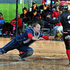 Tribune-Star/Jim Avelis<br /> Not this time: Patriot catcher Kelsey Coffey tags Terre Haute South baserunner Jena Renteria out as she attempts to reach home.