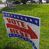 Tribune-Star/Jim Avelis<br /> Unheeded: Poll workers wait near the Booker T. Washington Center parking lot for voters to show.