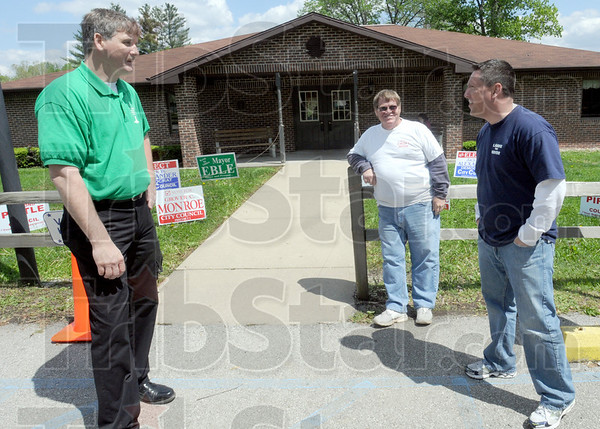 Friendly: Incumbent Sullivan Mayor Edward Eble, candidates for Mayor Phil Croft and Clint Lamb work the Hamilton #3 an #4 precinct Tuesday afternoon.