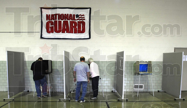 Tribune-Star/Jim Avelis<br /> Guarding freedom: Travis Baire casts his votes Tuesday while his father Dennis gets instruction from Francie Stevens at Brazil's National Guard armory Tuesday afternoon. Turnout was light with less then 20 percent of registered voters casting ballots by mid afternoon.