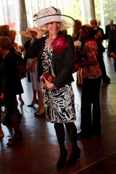 "(Denver, Colorado, May 4, 2011)<br /> Joyce Clegg with a purse by Nine West.  ""Luncheon By Design,"" an event sponsored by Neiman Marcus and The Design Council, at the Denver Art Museum in Denver, Colorado, on Wednesday, May 4, 2011.<br /> STEVE PETERSON"