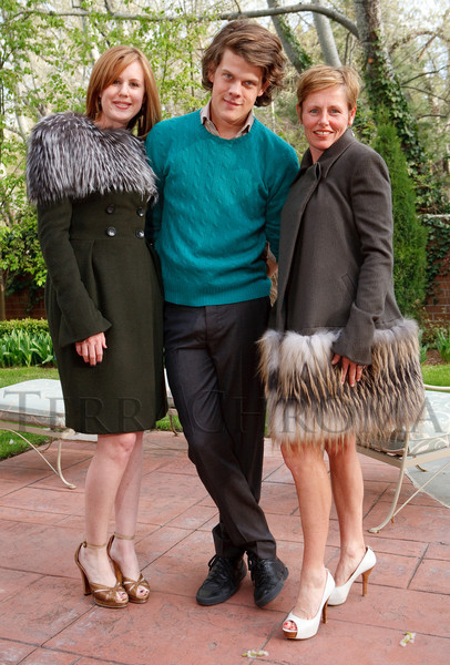 (Denver, Colorado, May 4, 2011)<br /> Taylor Pardun (forest green cashmere double-breasted coat with silver fox yoke), designer Wes Gordon, and Angela Pak (peat cashmere pyramid coat with Saga cross fox striae).  Trunk show by designer Wes Gordon at the home of Barbara Grogan in Denver, Colorado, on Wednesday, May 4, 2011.<br /> STEVE PETERSON